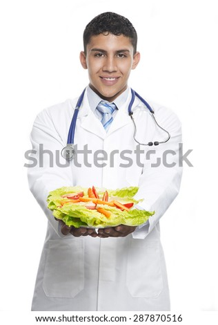 Young Doctor giving a salad concept for healthy eating and lifestyle or good diet and exercise - stock photo