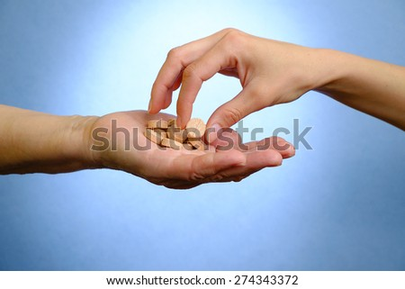 Young doctor helping the elderly woman - stock photo