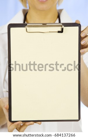young doctor holding a clipboard