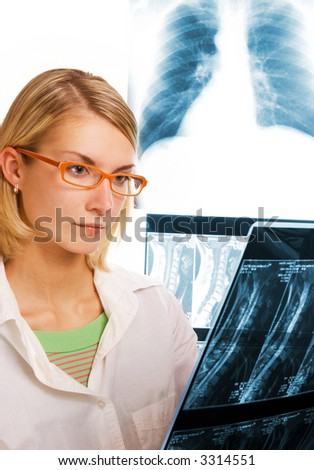 Young doctor looks at roentgenogram - stock photo