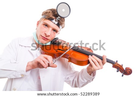 Young doctor playing the violin with scissors.