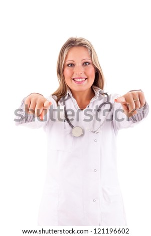 Young doctor pointing forward - isolated over white - stock photo