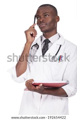 young doctor standing and thinking - stock photo