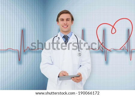 Young doctor using tablet pc against medical background with red ecg line - stock photo