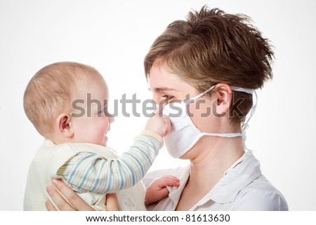 young doctor with baby on a white