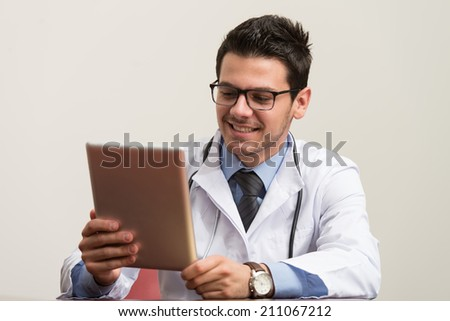 Young Doctor Working At His Computer - stock photo