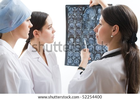 Young doctors checking an MR exposure - stock photo