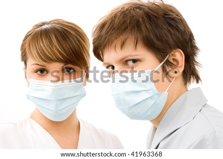 young doctors wearing protective mask on her faces