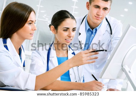 Young doctors working in hospital - stock photo