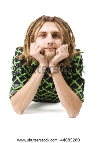 young dreadlock man lie isolated - stock photo