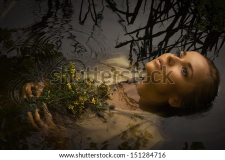 Young drown woman in a poetic representation. - stock photo