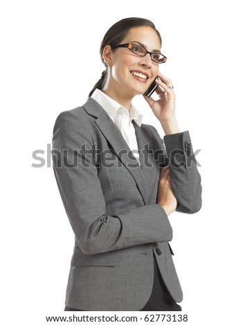 young, dynamic business woman talking on cell phone - stock photo