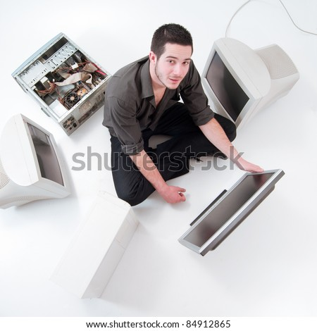Young electronics engineer making a computer repair