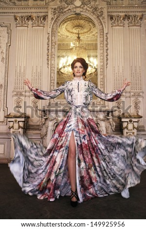 young elegance woman with flying dress in palace room - stock photo