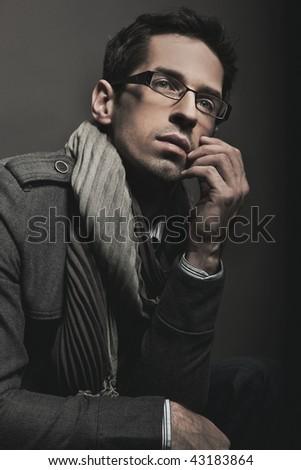 Young, elegant businessman thinking - stock photo