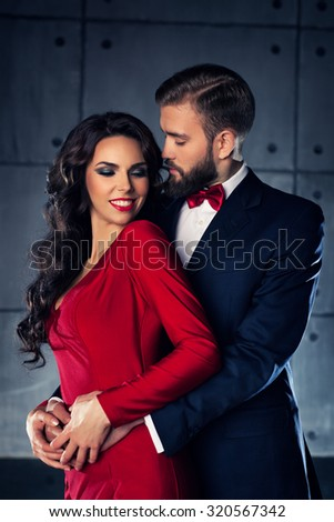 Young elegant embracing couple portrait. - stock photo