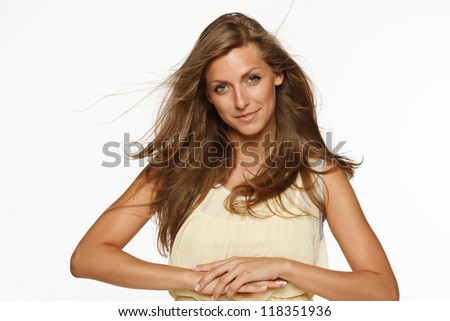 Young elegant female in light yellow summer dress, over white background - stock photo
