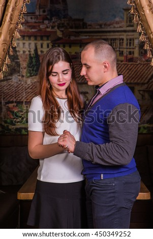 Young elegant in loved couple in luxury restaurant interior - stock photo