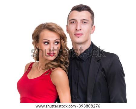Young elegant loving couple portrait, isolated on white - stock photo