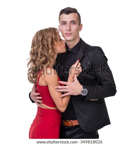 Young elegant loving couple portrait. Woman in red dress and man in black suit, isolated on white studio shot - stock photo