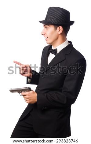 Young elegant man holding handgun isolated on white - stock photo