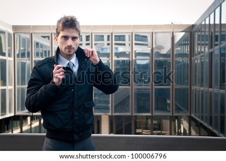 Young elegant man portrait with building background. - stock photo