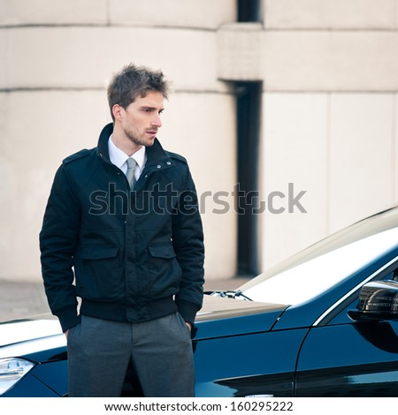 Young elegant man portrait with luxury car.  - stock photo