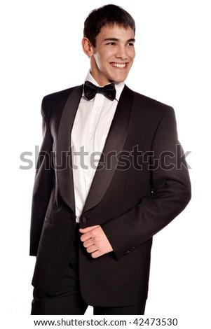 young elegant smiling man in tuxedo, studio on white - stock photo