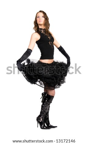 Young elegant woman holding her skirt. Isolated on white. - stock photo