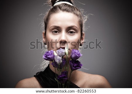 young elegant woman portrait with  flowers,  studio shot
