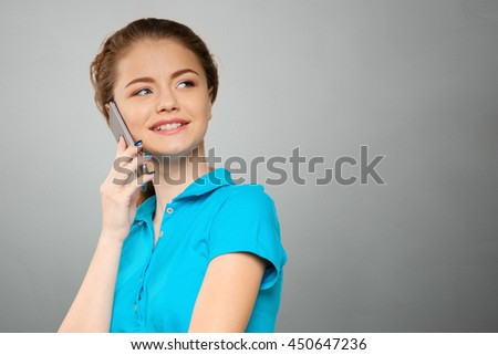 Young elegant woman talking on mobile phone - stock photo