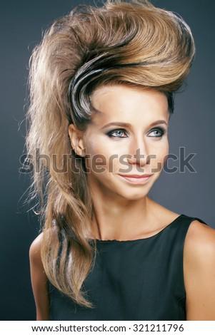 young elegant woman with creative hair style zebra print close up pretty like punk studio - stock photo