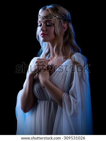 Young elf girl isolated on black - stock photo