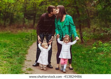 Young emotional family in the forest with kids