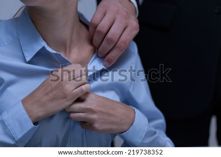Young employee and workplace harassment - stock photo