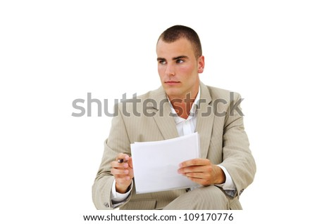 Young employee listening with attention and taking notes on paper - stock photo