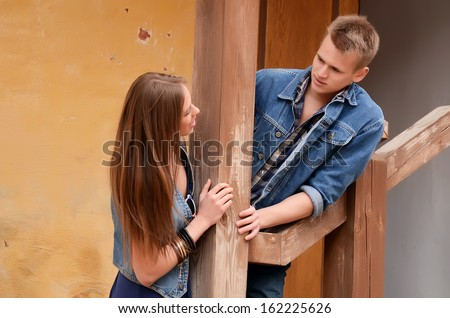 Young enamoured pair at the old house - stock photo