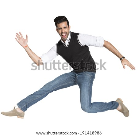 young energetic businessman rushing to the office, Happy man jumping in the air - stock photo