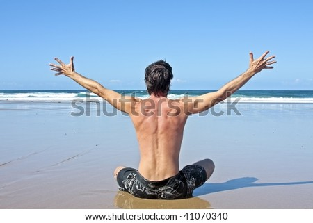Young energetic man enjoying freedom by the Atlantic ocean - stock photo