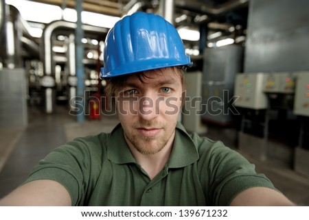 Young engineer in a power plant closeup photo