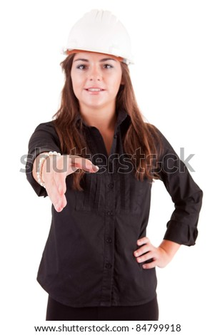 Young engineer offering handshake, isolated over white - stock photo