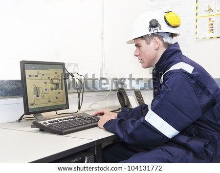 Young engineer working with computer in office. Indoor - stock photo