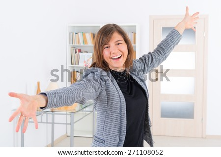 Young enthusiastic woman at home - stock photo