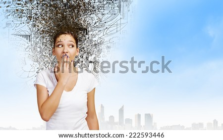 Young excited woman in casual closing mouth with palm - stock photo