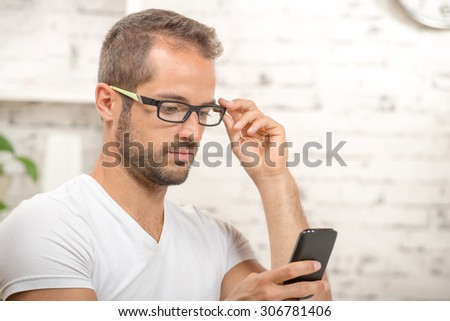 young executive looking his cellphone in his office - stock photo