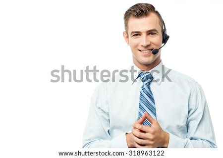 Young executive posing with hands clasped - stock photo