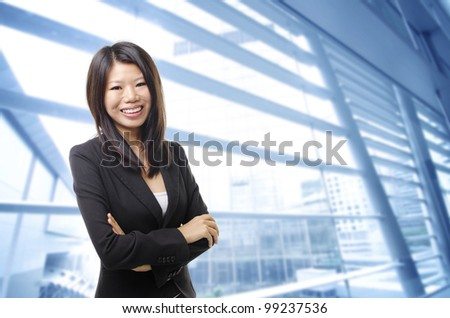 Young Executive standing in office building - stock photo