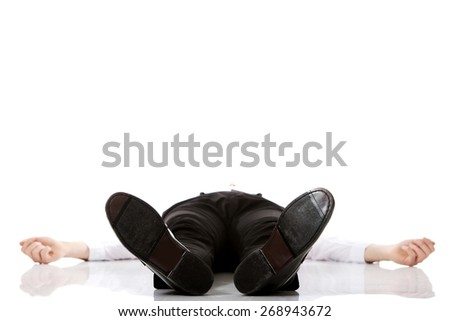 Young exhausted businessman lying on the floor. - stock photo