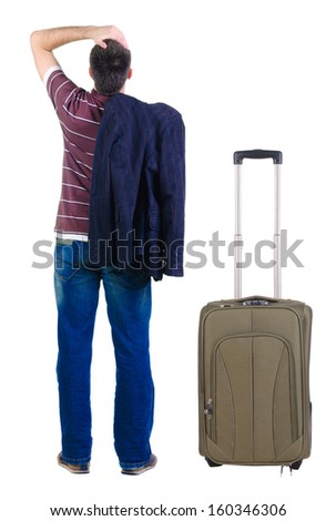 young expert traveling with suitcas looks ahead. rear view. Isolated over white . - stock photo