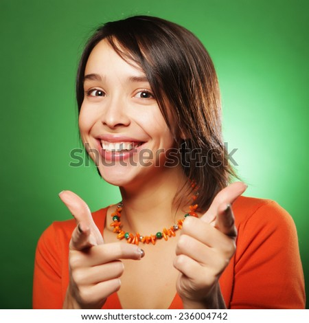 young expression woman over green background, happy time